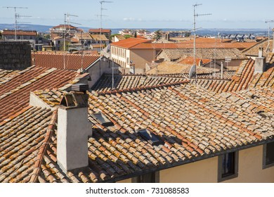 Detail of the roofs constructed with red tiles of palaces in Viterbo. Above the many homes there are fireplaces and television antennas.