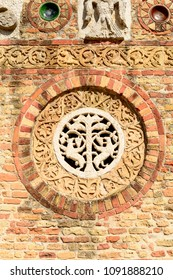 detail of round decoration on exterior wall of nartex at ancient Romanesque abbey, shot in bright spring sun light at Pomposa, Ferrara,  Italy