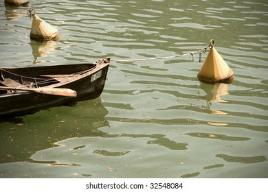 Detail of a rowing boat between two bouys