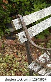 detail of rusty park bench