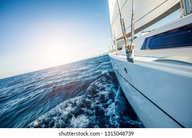 Detail of sailing yacht during voyage. Summer sport and recreation activities.