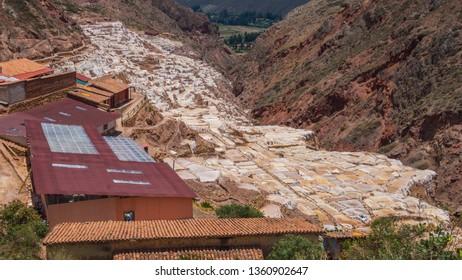 Detail of the salt terraces in the salt pans of Maras, salineras de Maras near Cusco in Peru, salt mines made by man. White salt