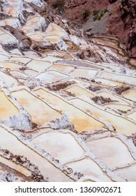 Detail of the salt terraces in the salt pans of Maras, salineras de Maras near Cusco in Peru, salt mines made by man