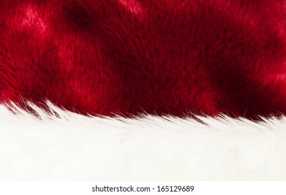 Detail Of Santa's Red and White Fur Hat Background Texture