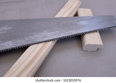 Detail of a saw with sawn wood