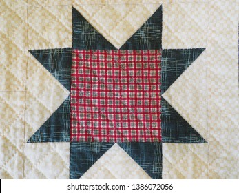Detail of Sawtooth Star Quilt Block with Hand Stitching in Plaid Fabrics