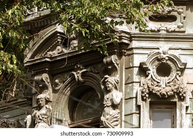 Detail of sculptural design of old Baroque building of  18th century. Carved decorations, bas-relief, coat of arms and heraldry, ornament on facade of building. Sculpture on facade