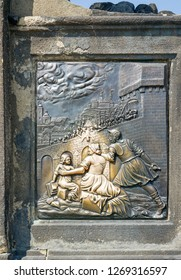 Detail of the sculpture of St. John of Nepomuk on the Charles Bridge in Prague
