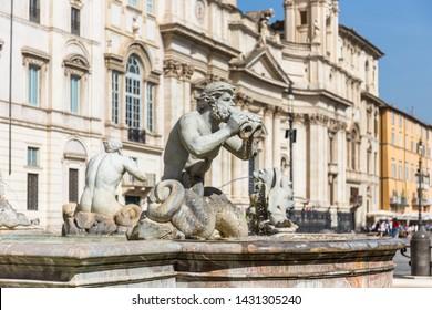 Detail sculpture of a triton, greek God. The Moor Fountain (Italian: Fontana del Moro) in Navona Square, Rome, Italy.