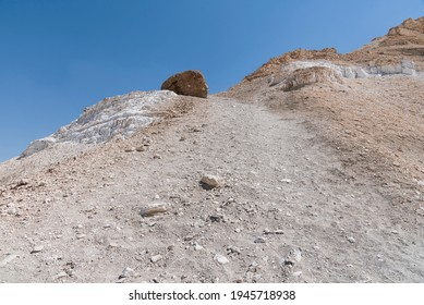 detail of a section a steep and daunting hiking trail up the Maale Divshon Ascent from the Zin Valley to the Divshon Plateau in Israel with a blue sky background