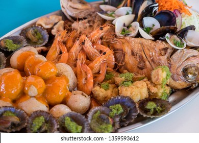 Detail with selective focus of a tray with assortment of fish and seafood at a restaurant on the coast in Gran Canaria, Canary Islands