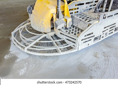 Detail of self leveling power trowel machine, sander, for smoothing surface on concrete slab.