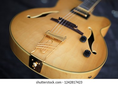 Detail of a semi-acoustic jazz guitar.
