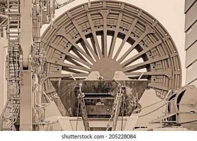 Detail in sepia from a cable drum, which is part of a deepwater construction vessel