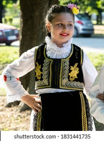 Detail of Serbia folk costume for woman with multicolored embroidery. Serbian folklore girl.