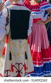 Detail of Serbian and Costa Rican folk costume for women, with multicolored embroidery.