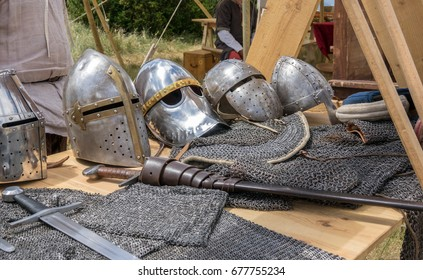 Detail of several medieval helmets helms and sword, chainmail and shields a medieval armor knight ready for battle detail