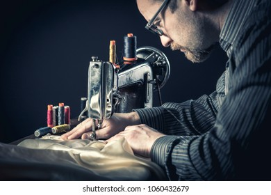 detail of sewing machine worker
