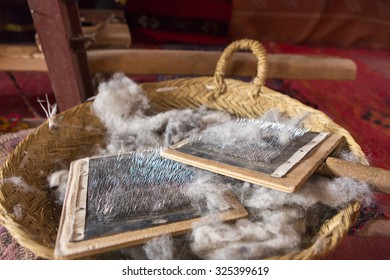 Detail of sheep wool brush to comb in a wicker basket, found in a traditional shop in Ait-ben-Haddou, Morocco