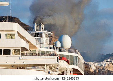 Detail of a ship funnel grey smoke from diesel engines.