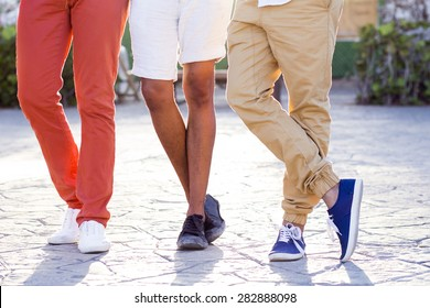 Detail of shoe-wear of a group of three young male