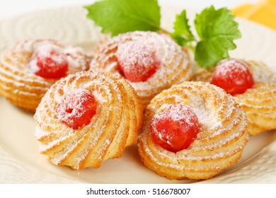 detail of shortbread cookies with jelly cherries