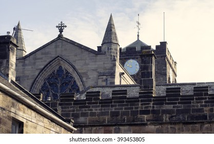 Detail shot of the clockface and surrounding roofs at Hexham Abbey in Northumberland.