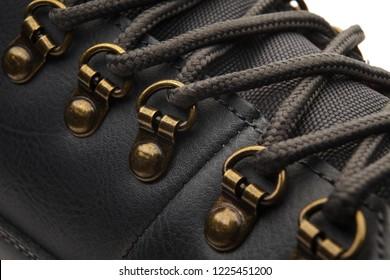 Detail shot of fragmrnt of new fashionable hiking mountain boot.