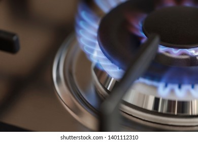 A detail shot of a gas burner on a kitchen stove