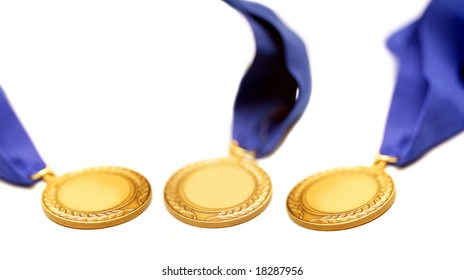 detail shot of a gold medals with blue ribbon