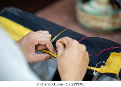 Detail shot of how the tailor are making a bisht, an Arabic cloak for men