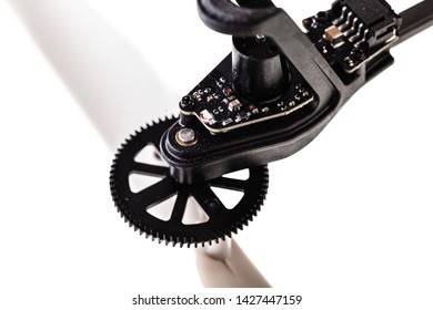 detail shot of the propeller rotor of a quad copter spy drone isolated over a white background
