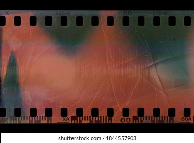 detail shot of short 35mm film snip or strip on black background with scratches and fingerprint texture.