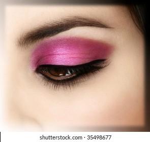 Detail shot of a woman's eye with beautiful fashion make-up