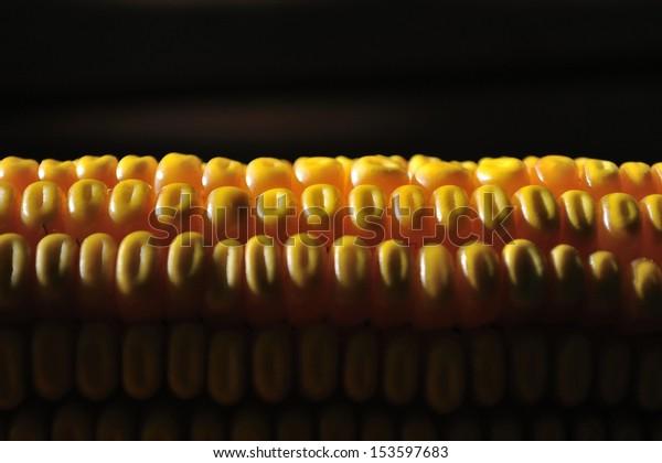 Detail shot of yellow corn against black dark background