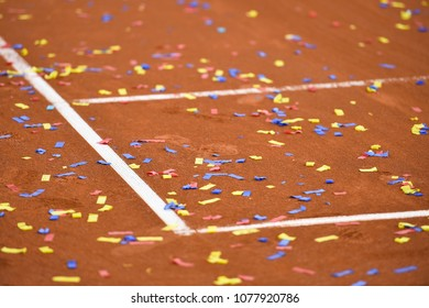 Detail show with confetti on a tennis clay court