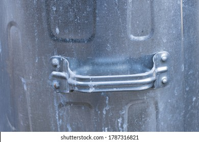 detail of the side handle from a tin bin