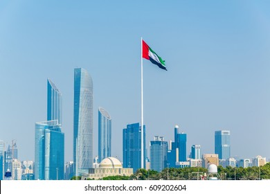 Detail of skyscrapers in Abu Dhabi with the local flag, UAE