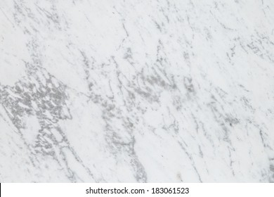 Detail of a slab of expensive luxurious white and grey Carrara marble