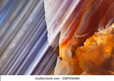 Detail of a slice of natural stone agate. Natural patterns and textures of minerals for background. Natural stone agate surfaces, backgrounds and wallpapers.