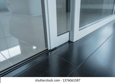 detail of sliding door frame install with floor laminate and floor tile joint together