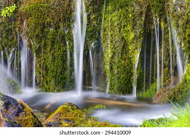 Detail of a small waterfall in the Gjain valley in Iceland