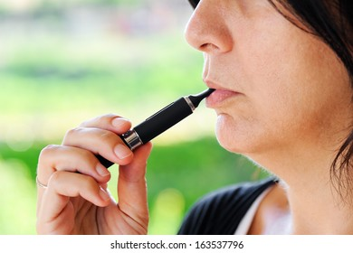 Detail of a smoker of Electronic Cigarette