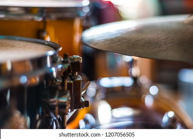 Detail of the snare drum with ride cymbal part on focus and bokeh on background