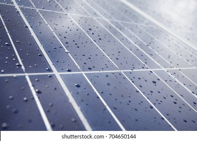 Detail of Solar Panel plates with drops of rain. Solar Photovoltaic (PV) in selective focus