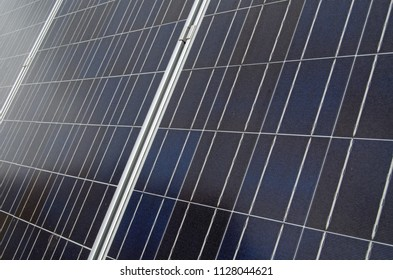 Detail of solar panels soaking up the sun's rays on a roof in London.
