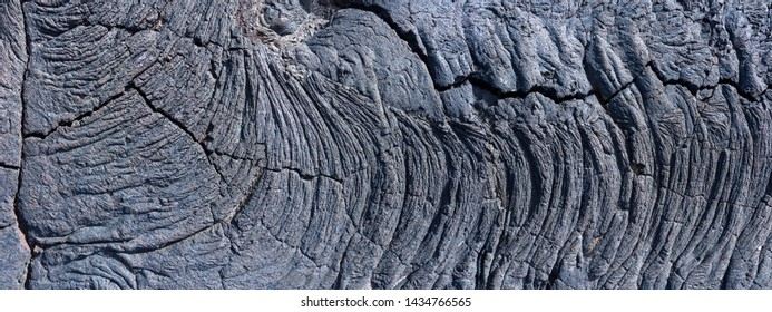 Detail of a solidified, partly broken lava as a panoramic shot, taken on the island of El Hierro, Canary Islands