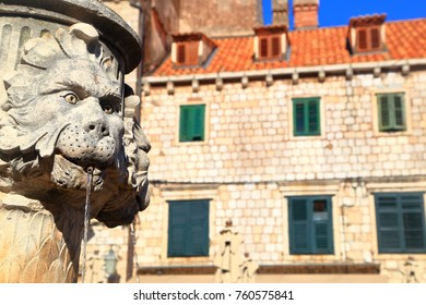 Detail of some stone carved lion heads on a fountain in Dubrovnik, Croatia