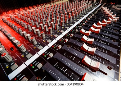detail sound mixer in red and white light with great perspective