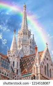 Detail of the St. Matthias Church's tower in Budapest, Hungary. Rainbow over the building.
